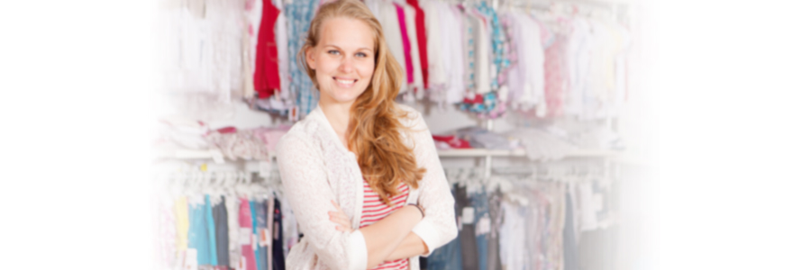 Smiling Owner of Retail Clothing Shop